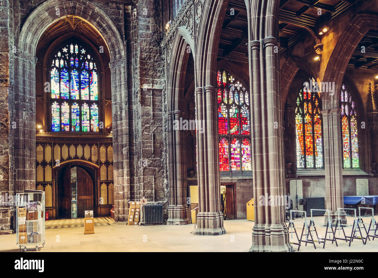 Interior of the Manchester Cathedral with impressive mosaic windows and gothic decorations, England, UK - Stock Image