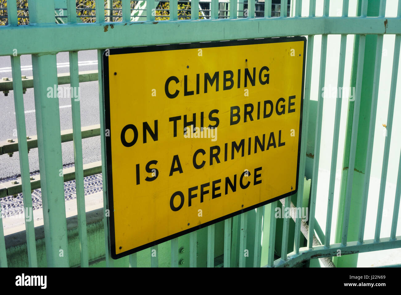 Warning sign attached to Runcorn Bridge stating it is a criminal offence to climb on the bridge structure. - Stock Image