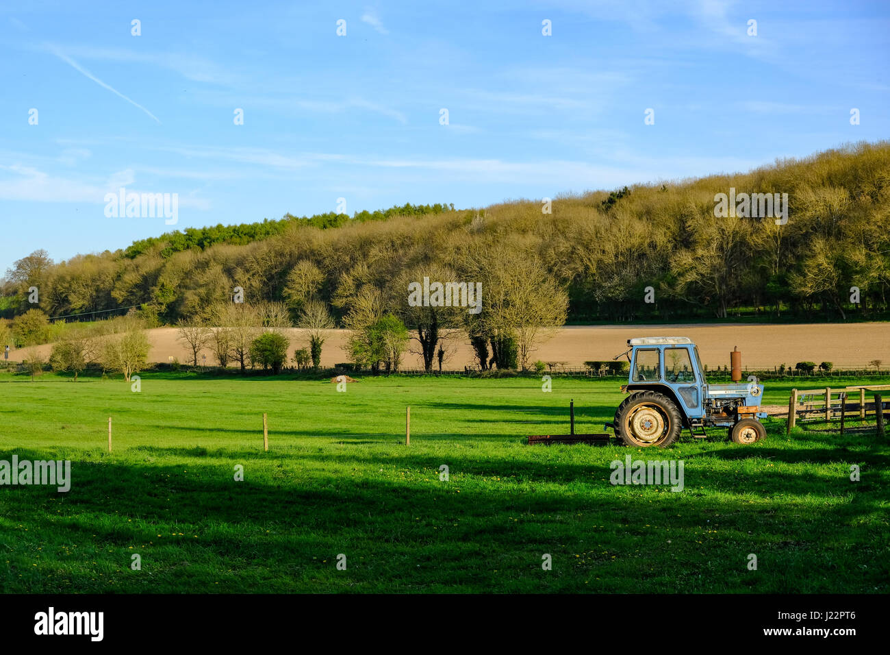 Tractor in the English countryside. - Stock Image