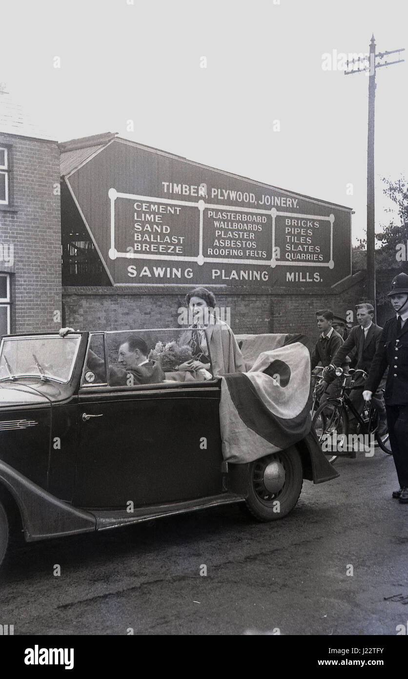 1950s, Miss Astria, winner of the Royal Air Forces Association (RAFA) beauty pageant sitting in an open top car Stock Photo