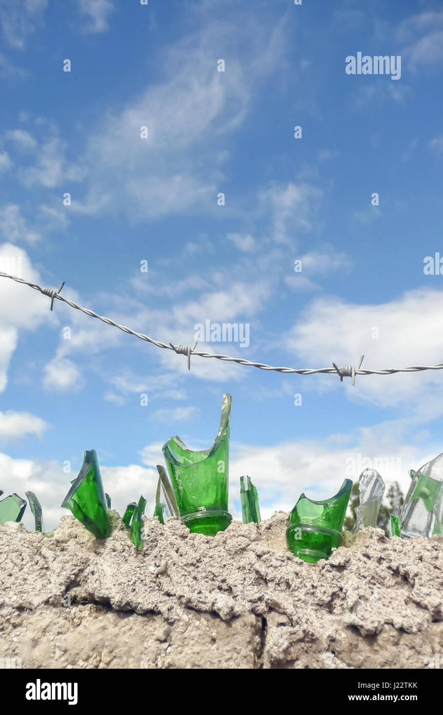 broken glass and barbed wire security Stock Photo: 138975527 - Alamy