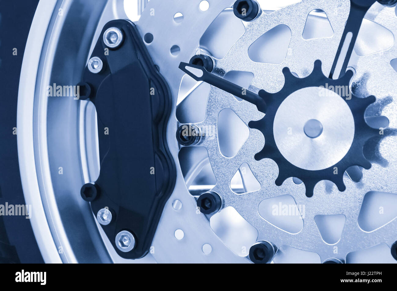 blue toned macro of a clock mechanism - Stock Image