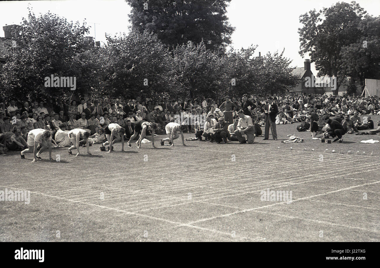 1950s, historical, sprinters about to start a race at the Buckinghamshire Amateur Athletic Association Championships, - Stock Image