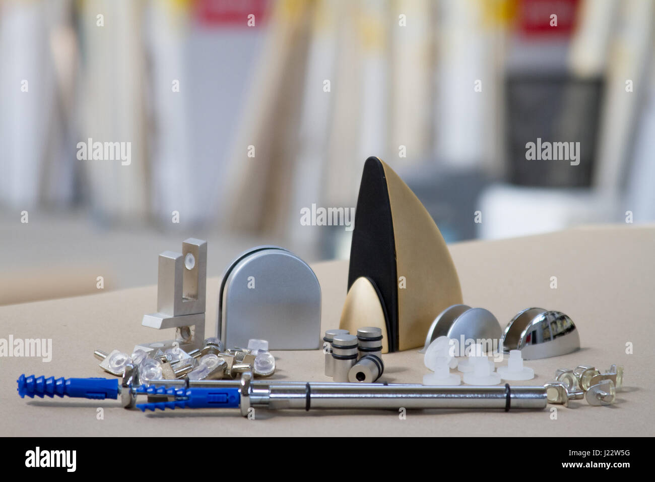 Mount for glass shelves or wood. Fasteners for furniture, shelves of different materials, different colors and shapes. - Stock Image