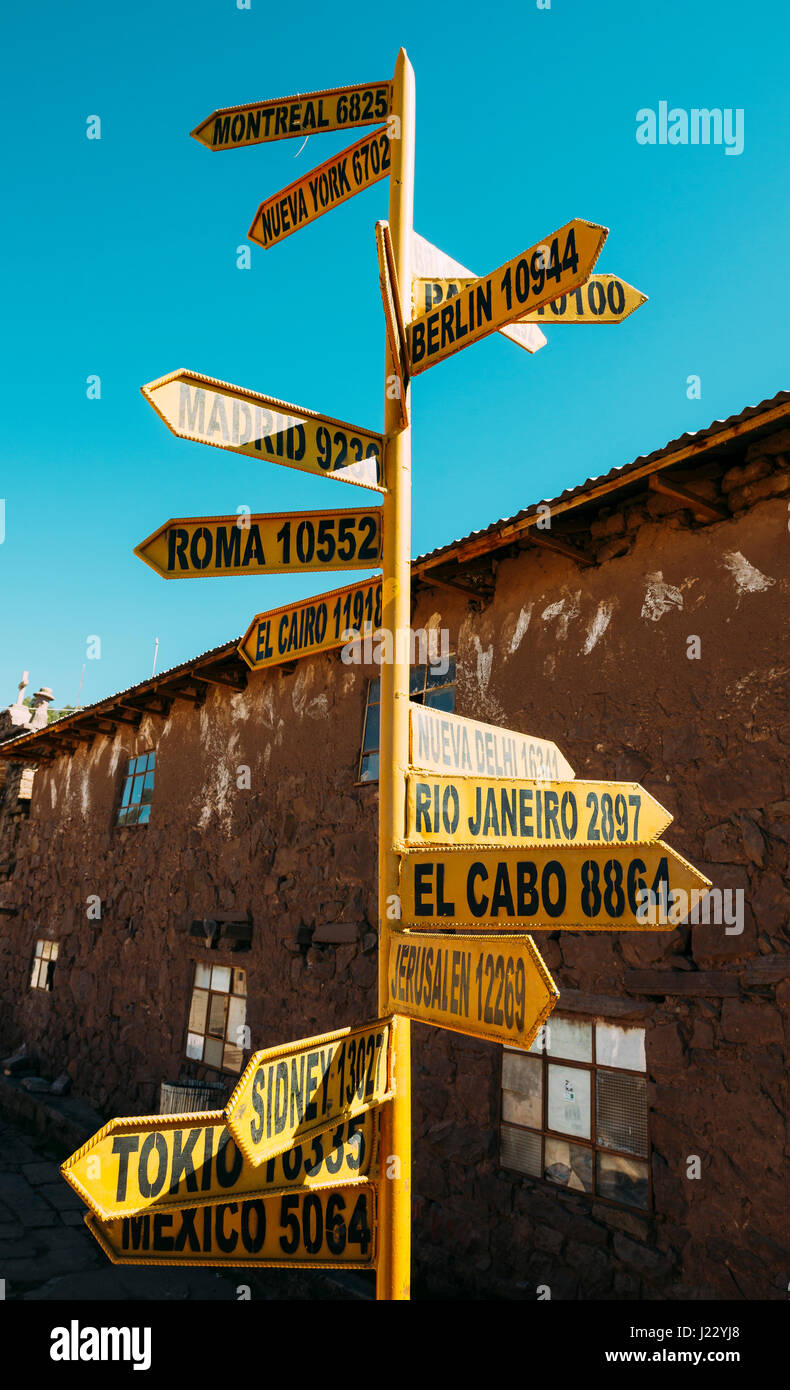 Taquile island, Titicaca lake, Peru. Sign post with cties and distances - Stock Image