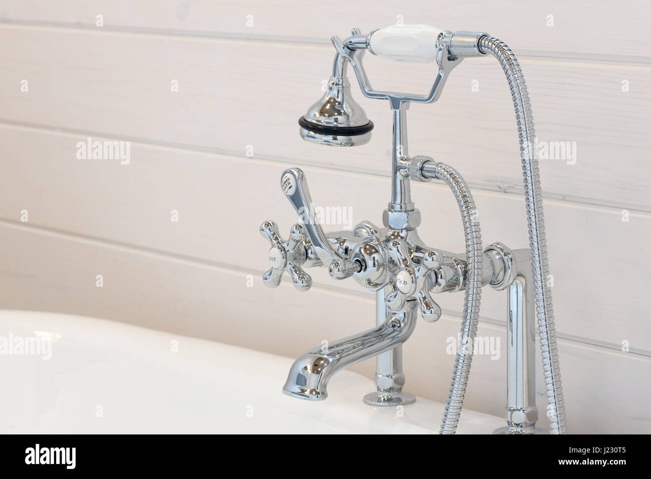 Vintage bathtub faucet and shower head Stock Photo: 138978789 - Alamy