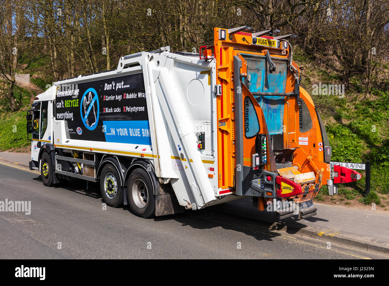 dustbin lorry waste collection service UK council service UK England truck disposal of home waste Stock Photo