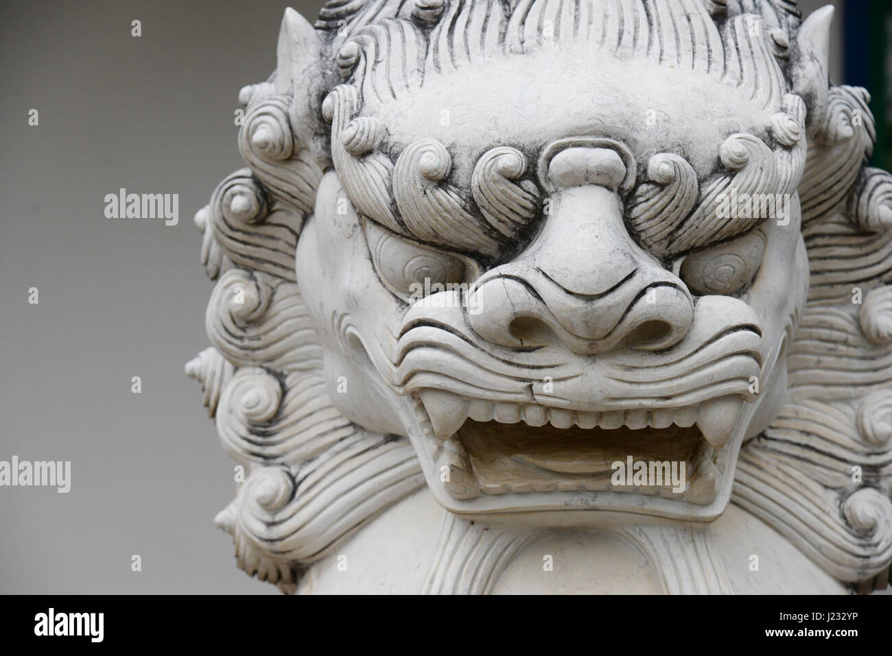 Chinese stone lion statue architecture guardian in chaina culture Stock Photo