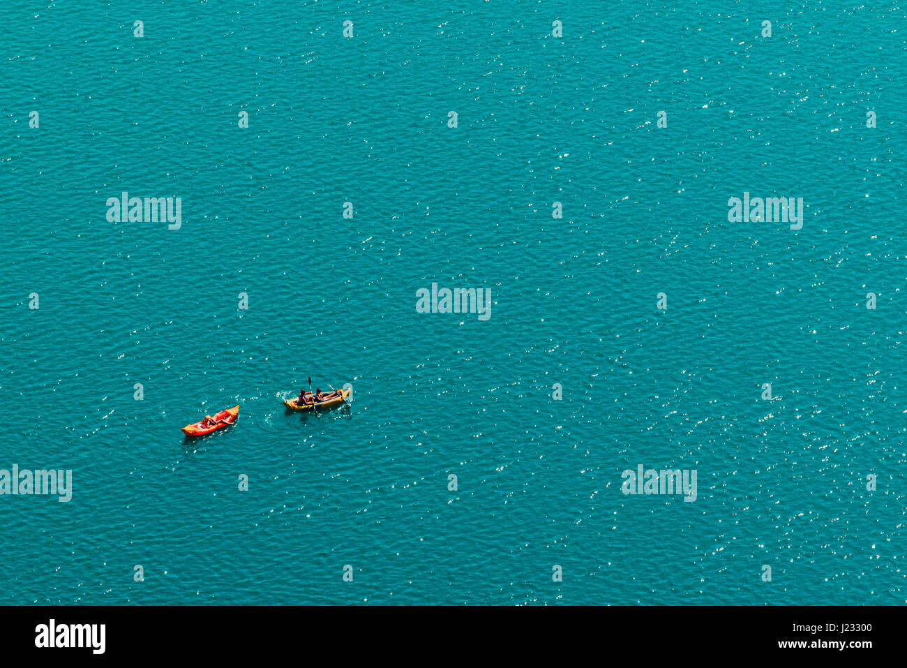 Unrecognizable people enjoying hot summer afternoon in boats on lake Bled, aerial view of leisure and recreational - Stock Image