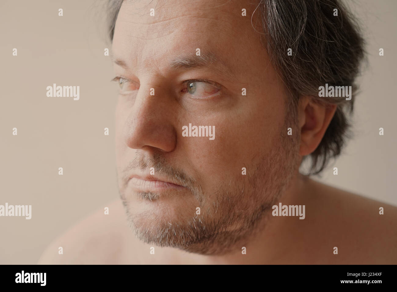 middle aged man gazing into distance - Stock Image