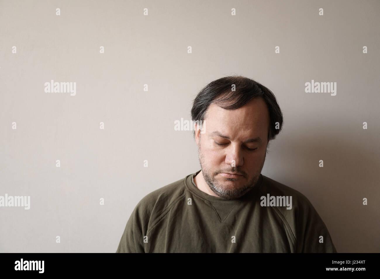 depressed man in his forties - Stock Image