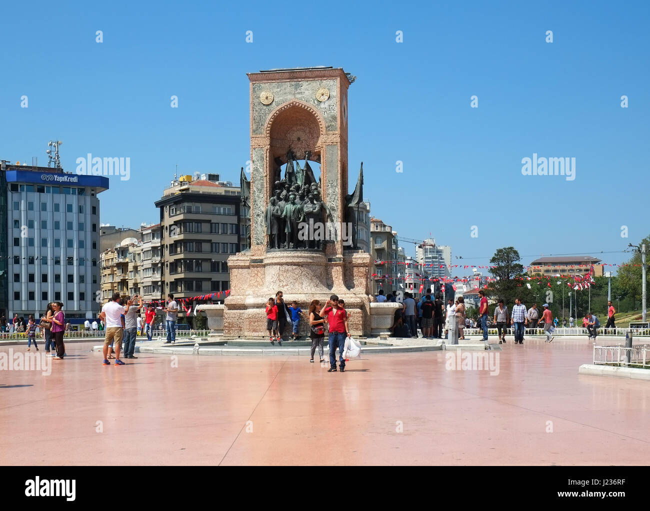 ISTANBUL, TURKEY - JULY 13, 2014: Monument of Republic on Taksim Square commemorate the formation of the Turkish Stock Photo