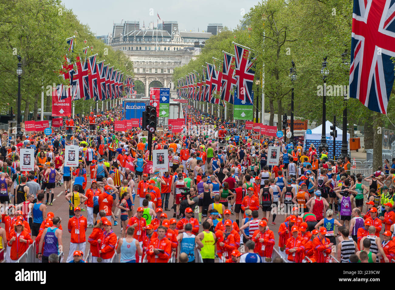 A mass of runners in the 2017 Virgin Money London Marathon cross the finishing line on The Mall. Credit: Malcolm - Stock Image