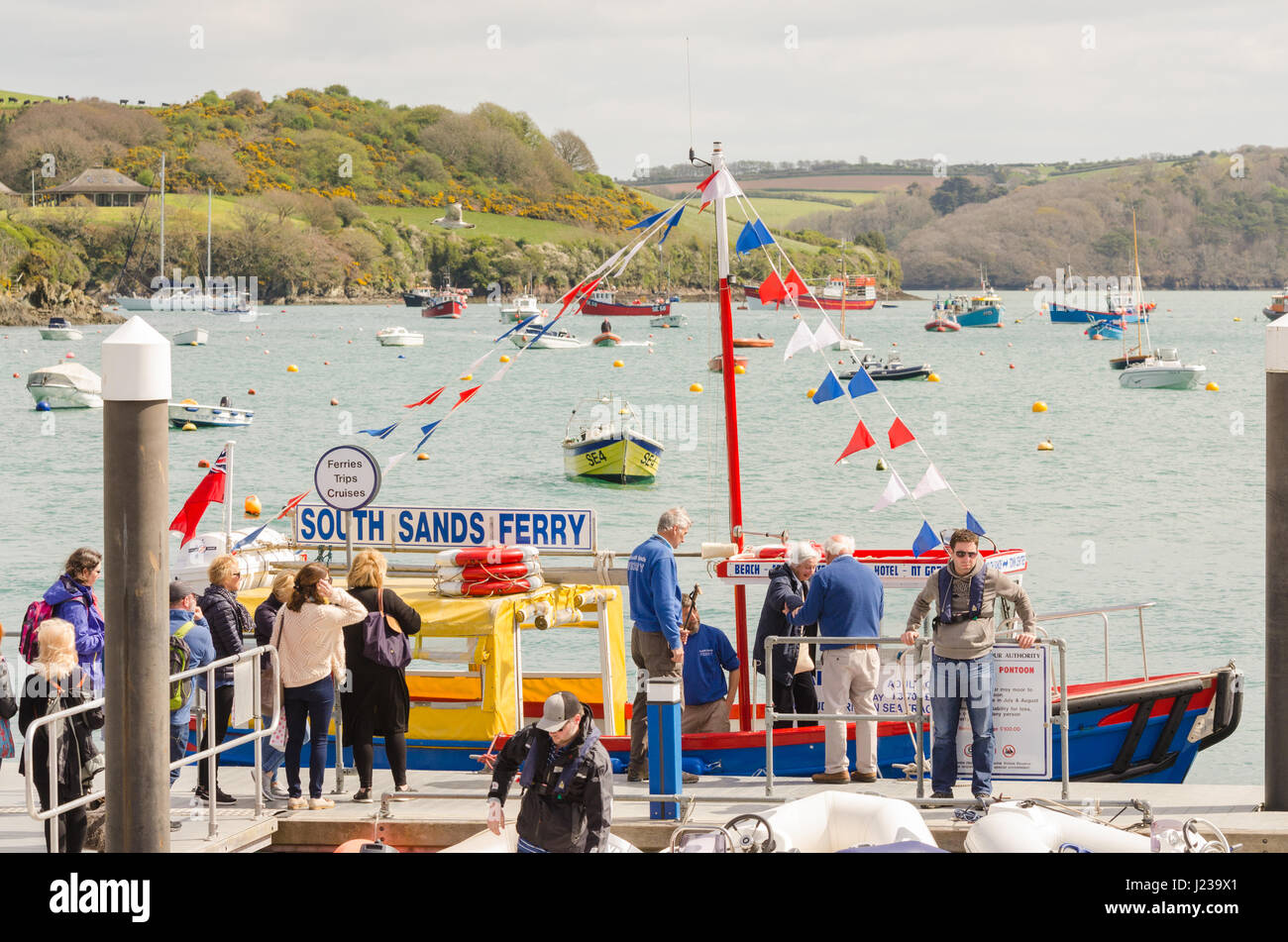Passengers boarding the South Sands Ferry at Whitestrand in Salcombe, Devon - Stock Image