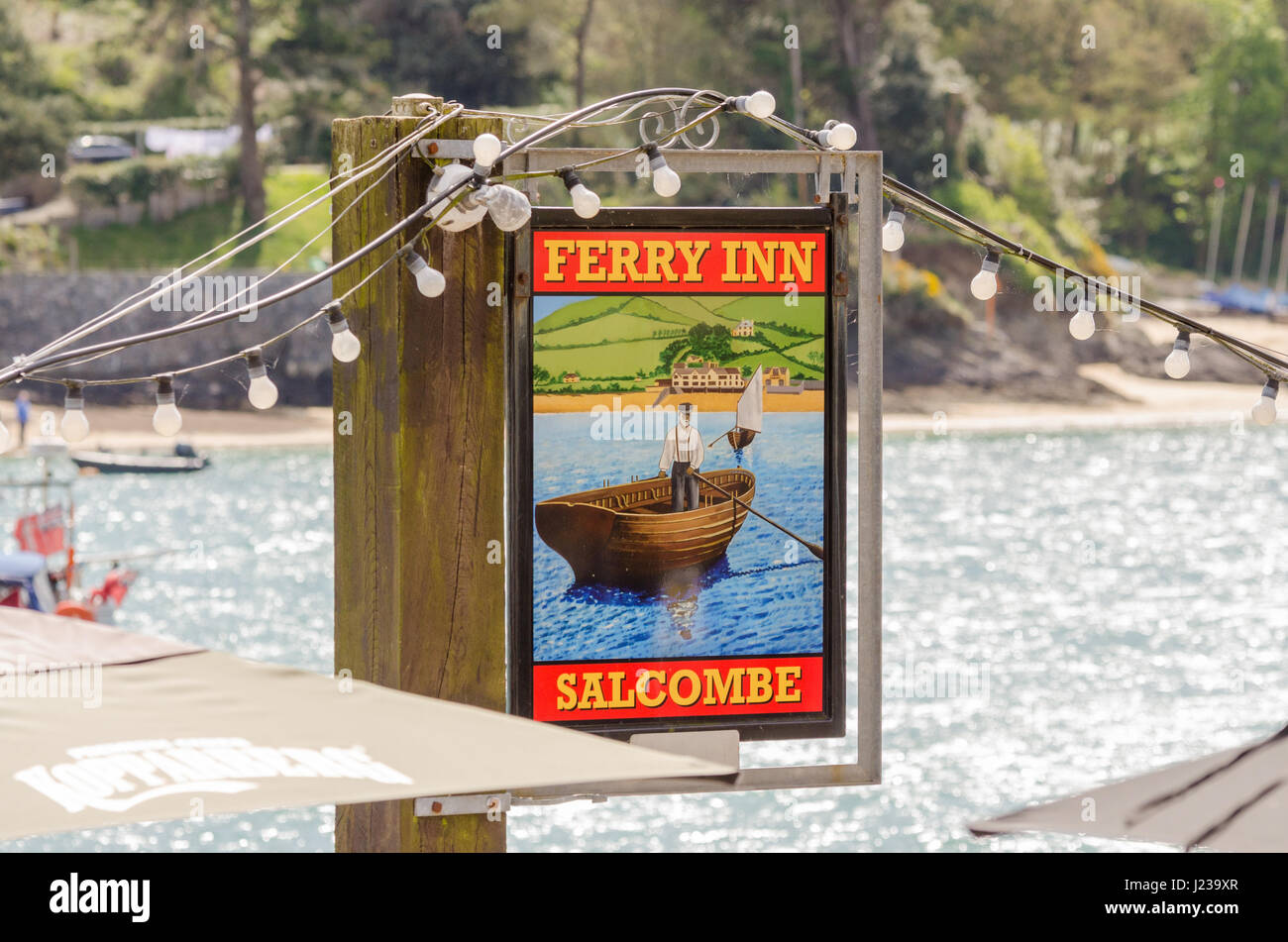 Colourful hanging sign for the Ferry Inn pub in Salcombe, Devon - Stock Image