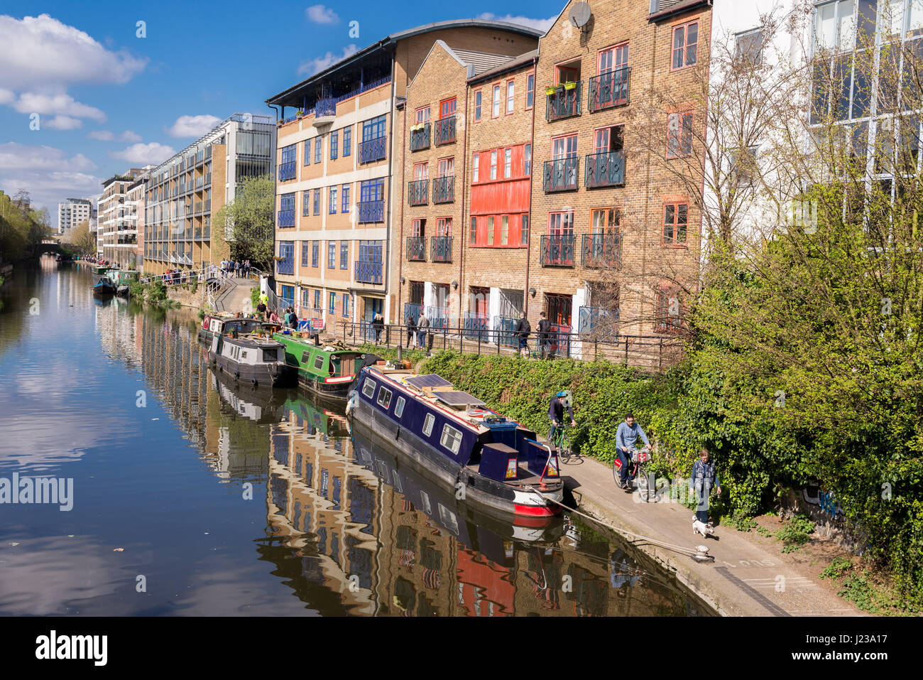 People walking along a stretch of the Regent's Canal in Haggerston, Hackney, East London. Known as the Haggerston - Stock Image