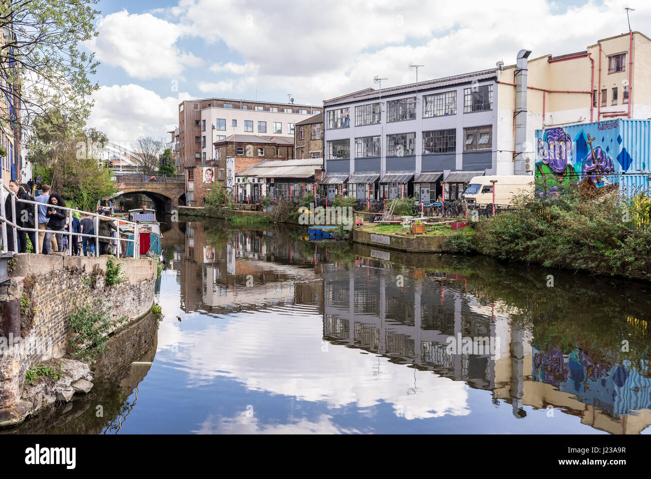 A stretch of the Regent's Canal in Haggerston, Hackney, East London. Known as the Haggerston Riviera and lined - Stock Image