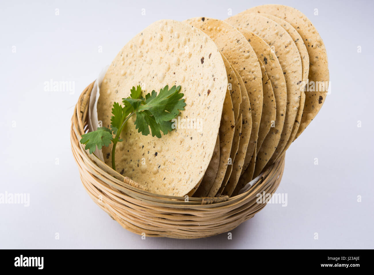 Indian snacks, deep fried crackers or papad. Mung dal and urad dal papad an Indian fried dish, which is an side - Stock Image