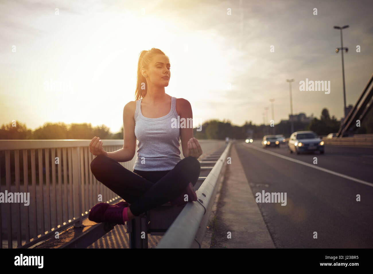 Beautiful female getting away from urban fast paced life - Stock Image