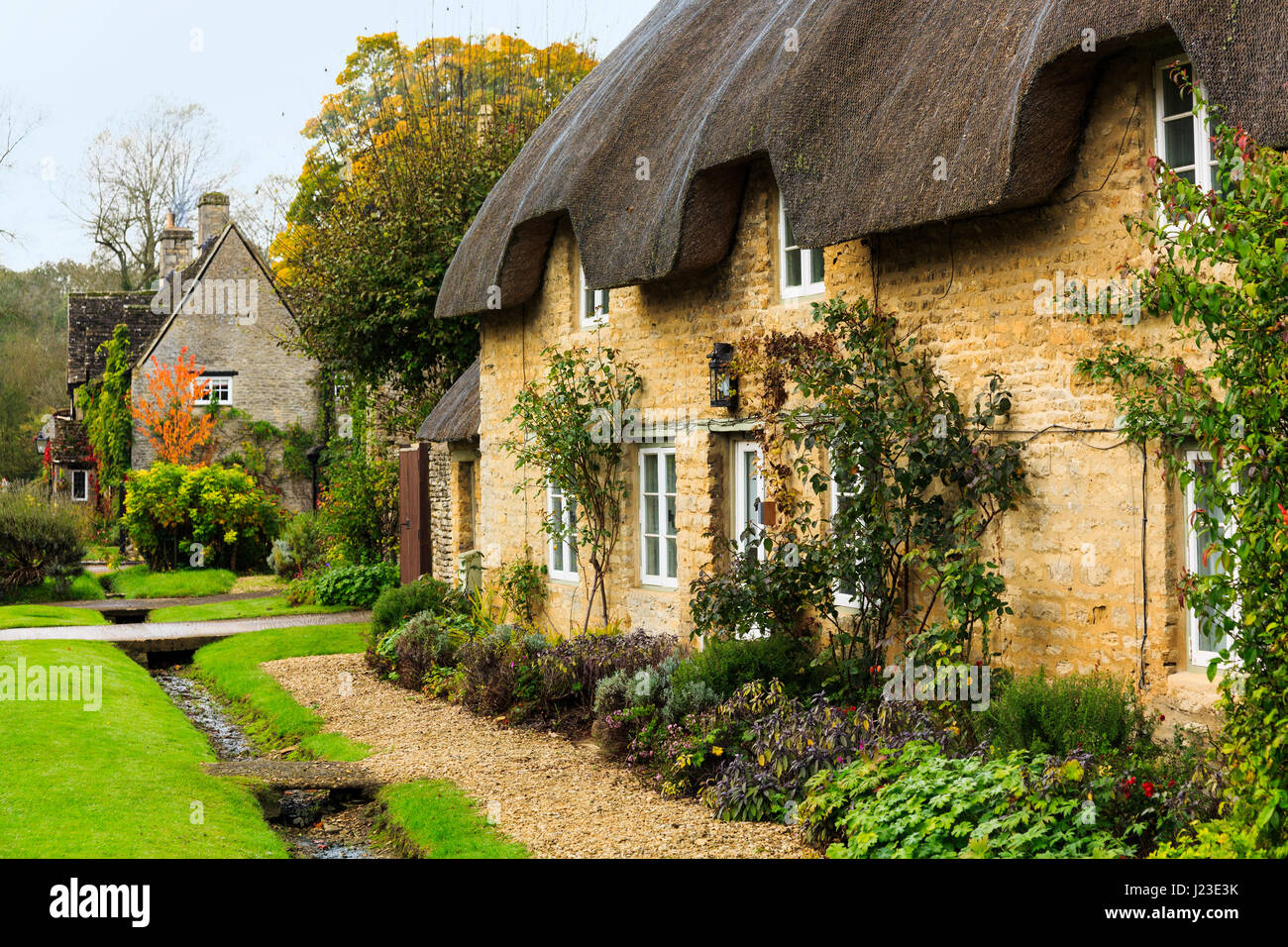 Minster Lovell village houses cottages in the Cotswolds, England, UK - Stock Image