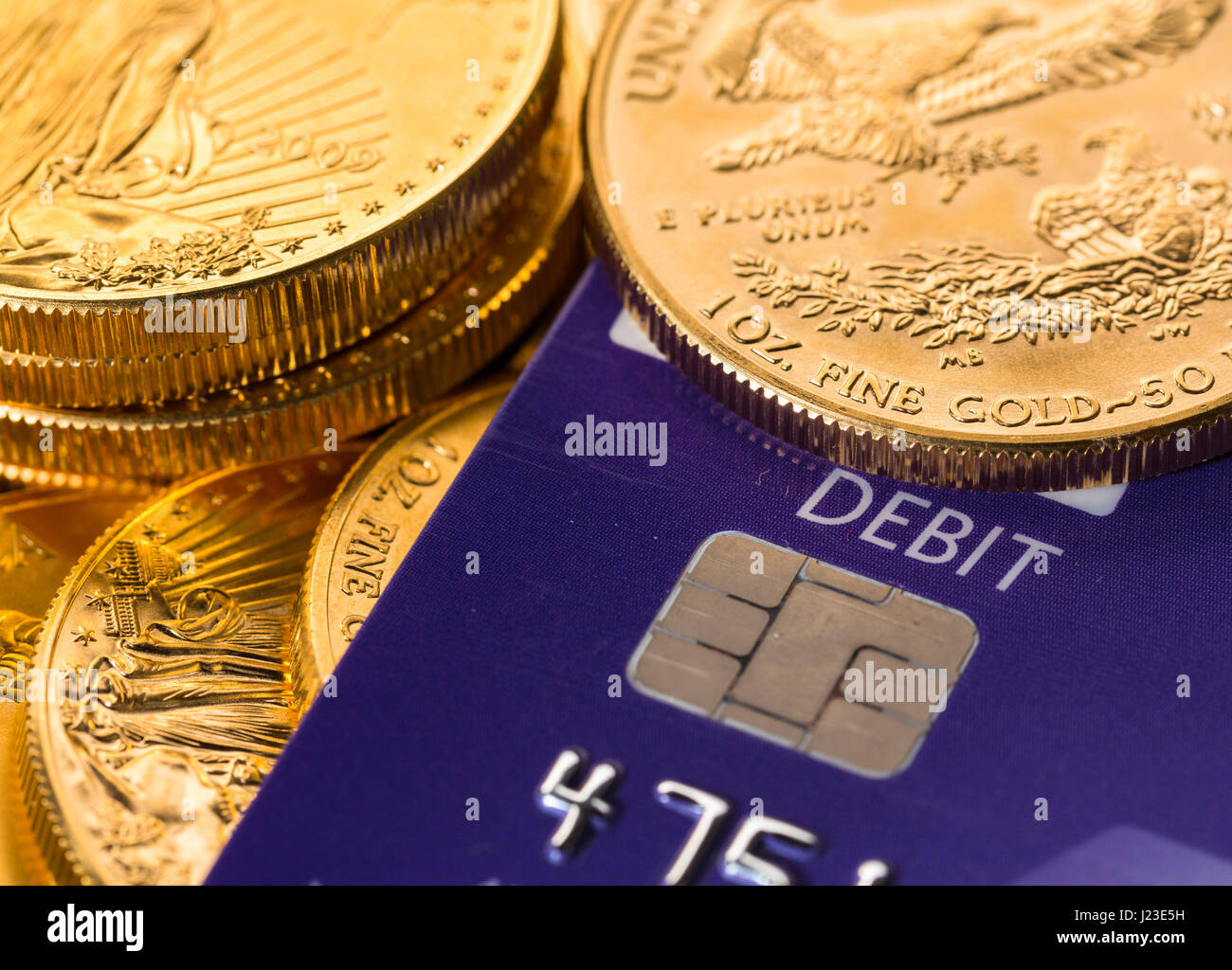 American Gold Eagle 50 dollar gold bullion coins with credit debit card - Stock Image