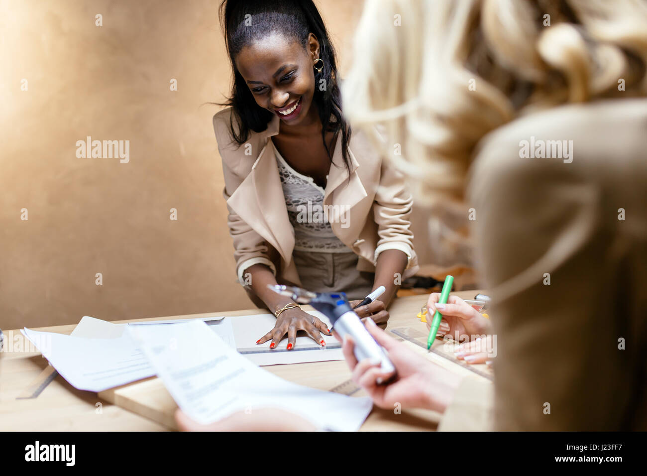 Creative group of people designing and working in workshop - Stock Image
