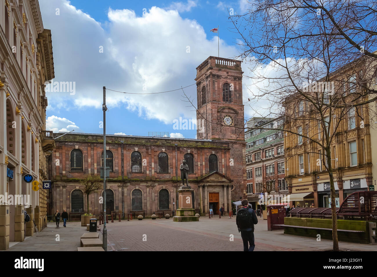 Exterior view of the Saint Annes Church in Manchester, UK. View of the St. Annes square and the statute Stock Photo