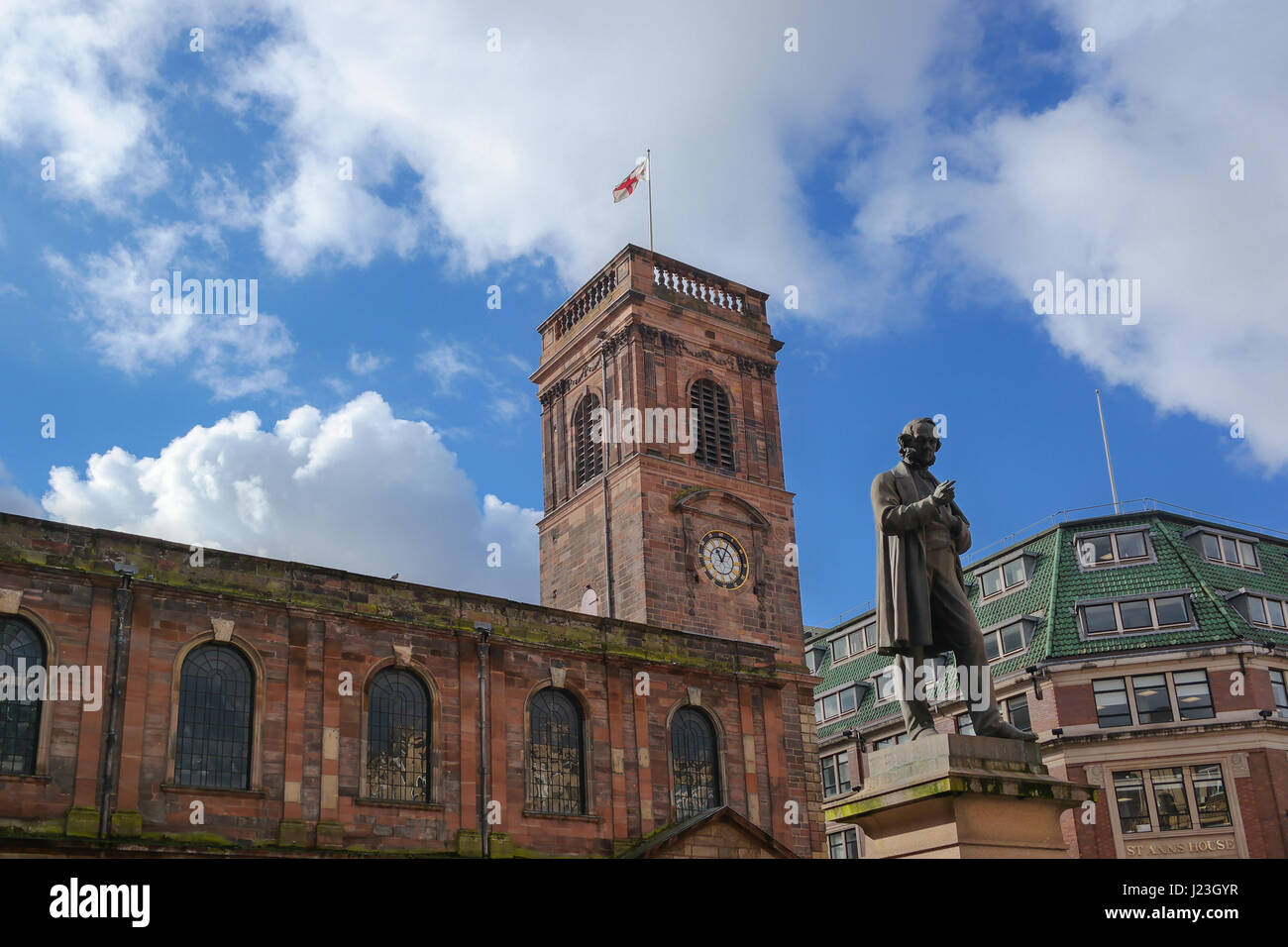 Exterior view of the Saint Ann's Church in Manchester, UK. View of the St. Ann's square and the statute Stock Photo