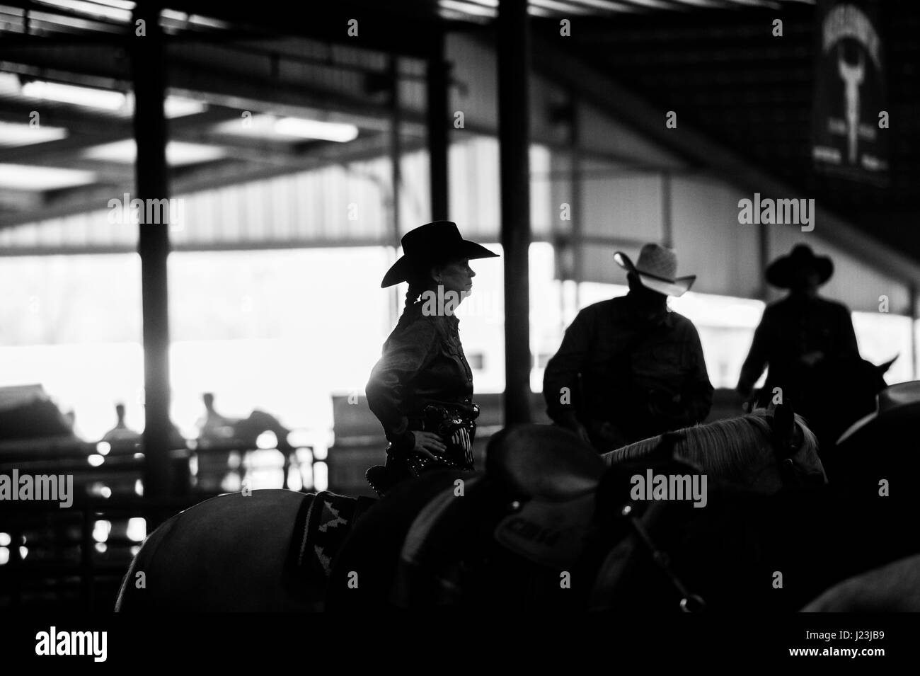 Salado, Texas, USA. Cowboy Mounted Shooting Event Texas. Riders silhouette before the competition. - Stock Image