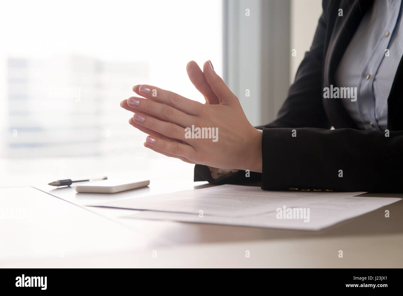 Close up of female hands put together, concentration or nerves Stock Photo