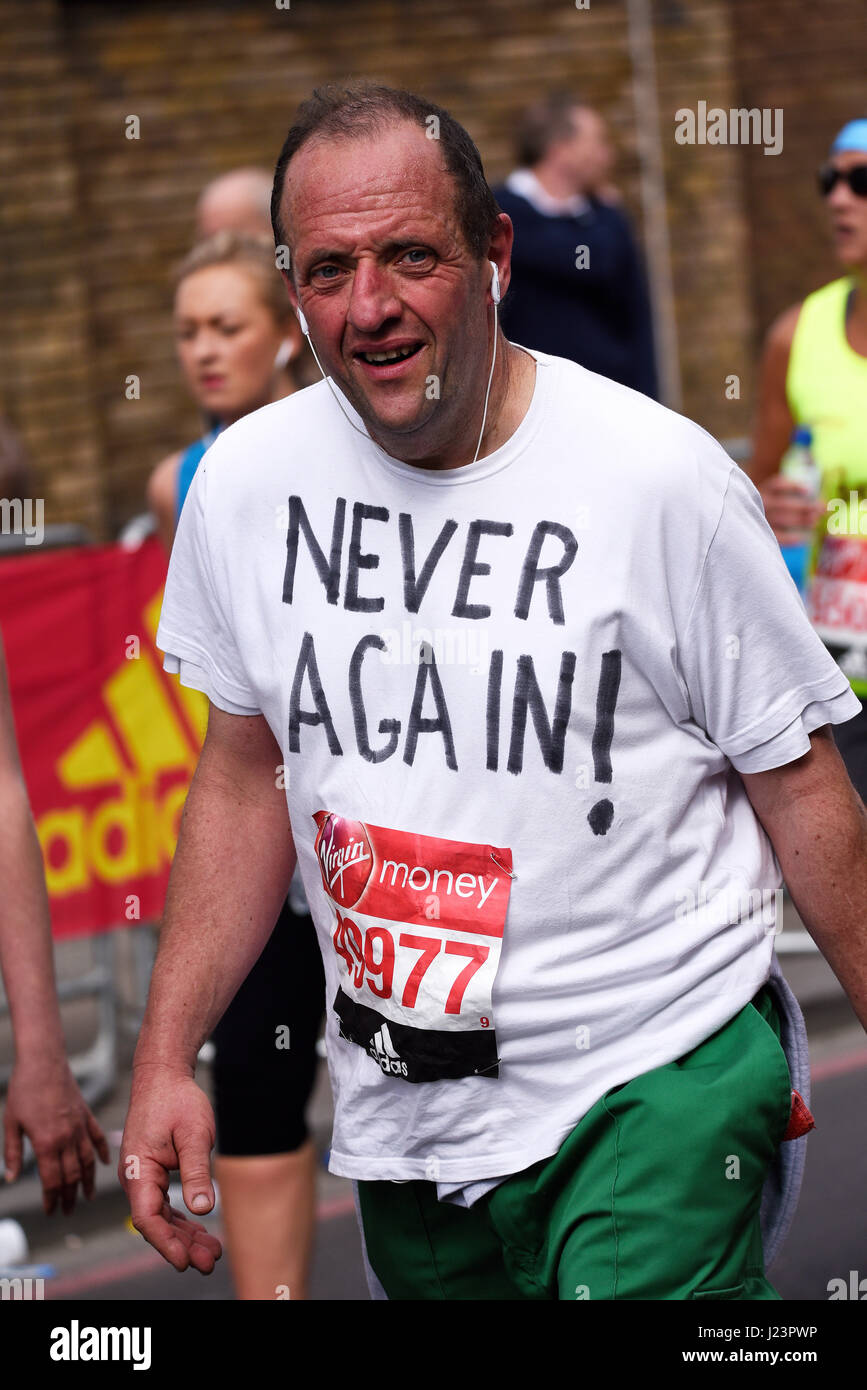Paul Enville with Never Again at the 2017 Virgin London Marathon after crossing Tower Bridge and alongside the Tower - Stock Image