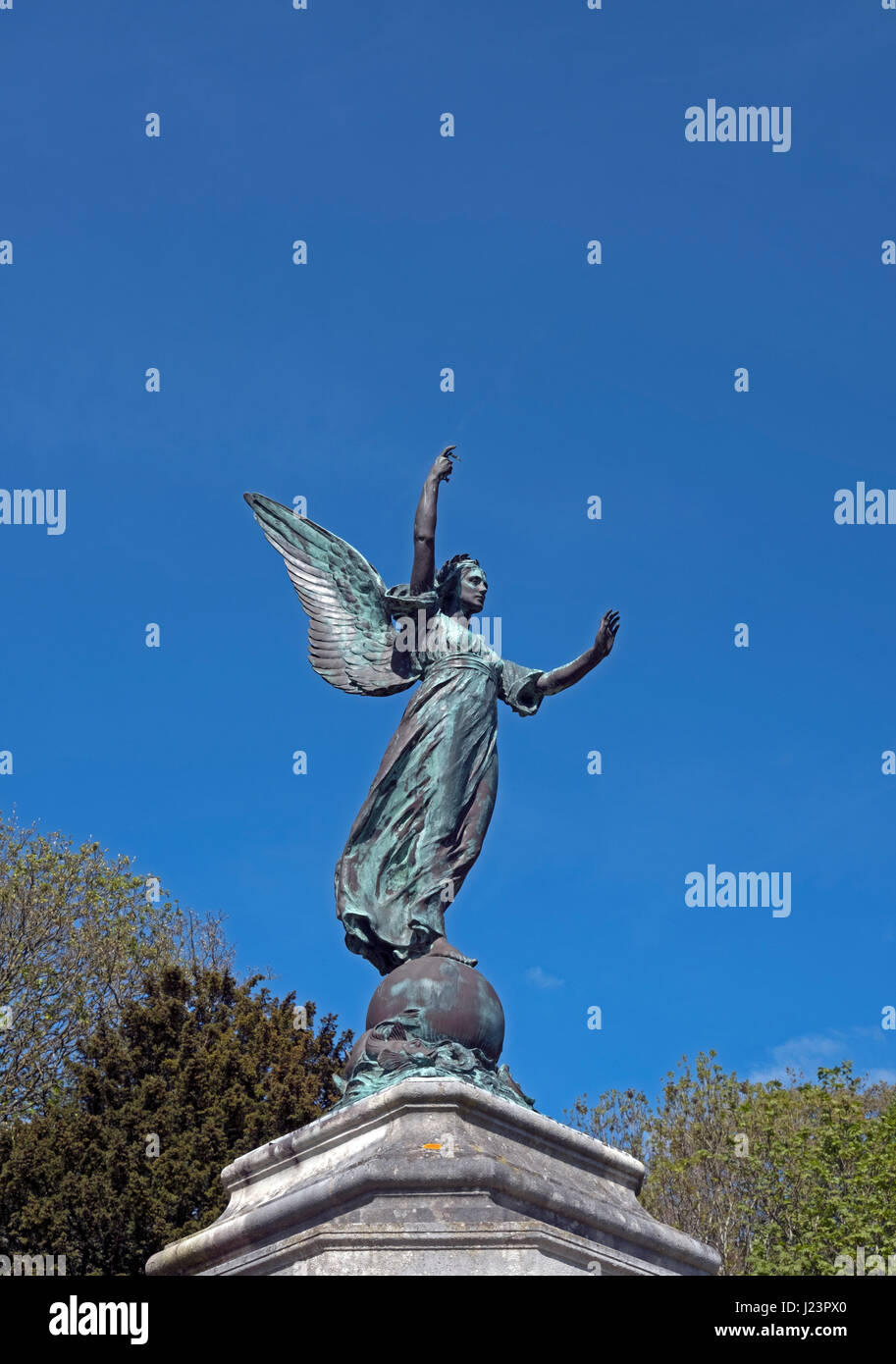 A statue of a winged Victory by Alfred Drury which surmounts the war memorial in Grove Park, Weston-super-Mare, - Stock Image