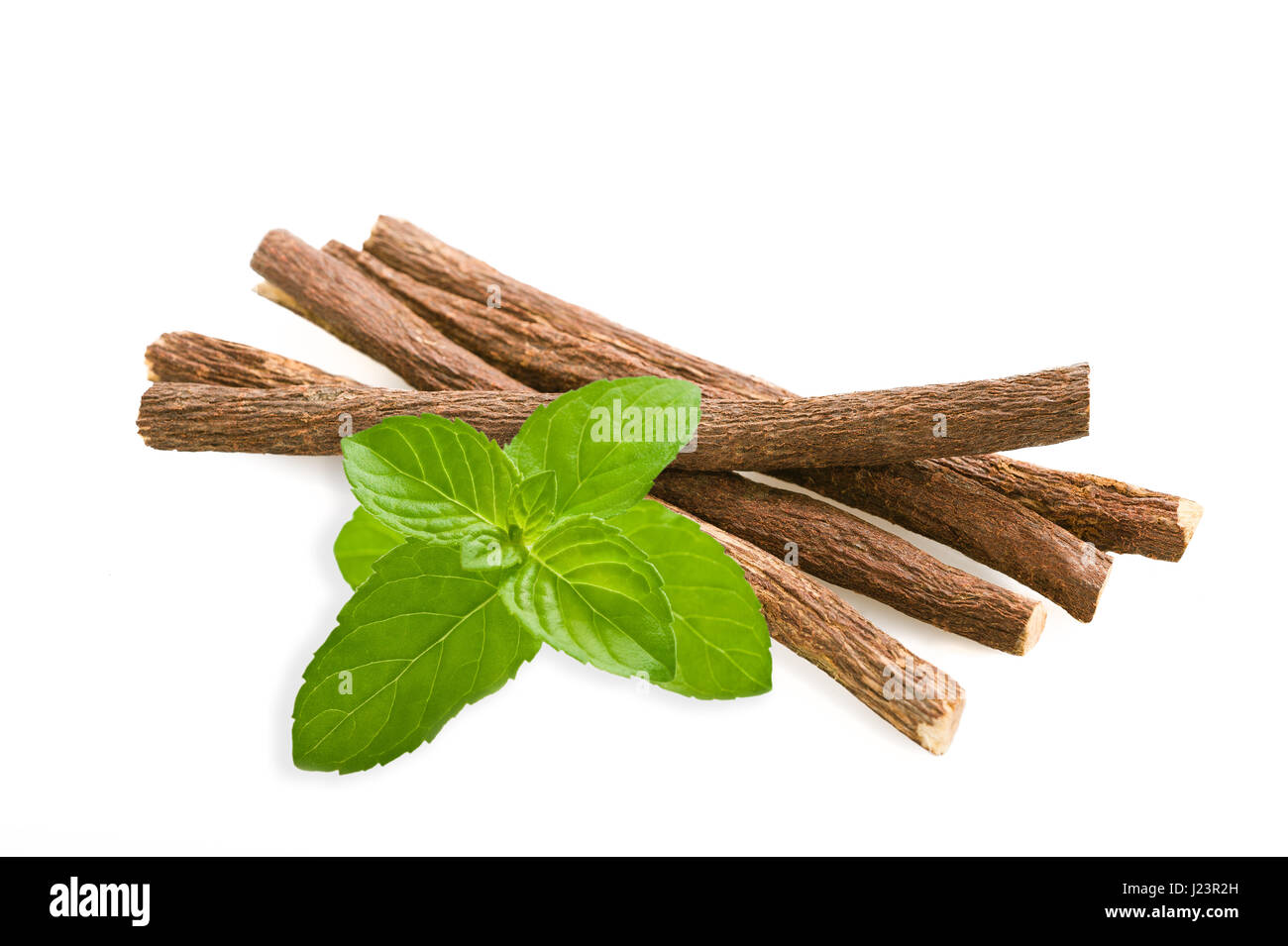 Roots licorice and mint isolated on white - Stock Image