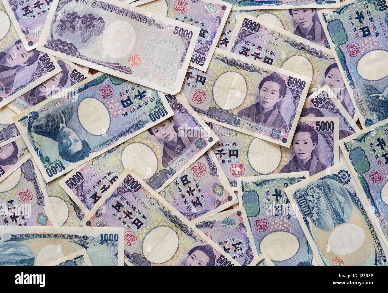 5000 and 1000 Japanese Yen banknotes. - Stock Image