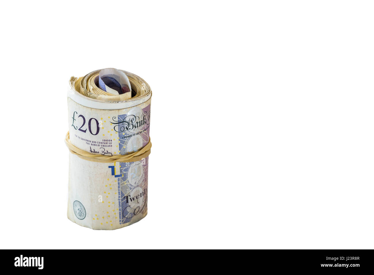 Roll or bundle of cash.Stass of twenty pound notes. - Stock Image
