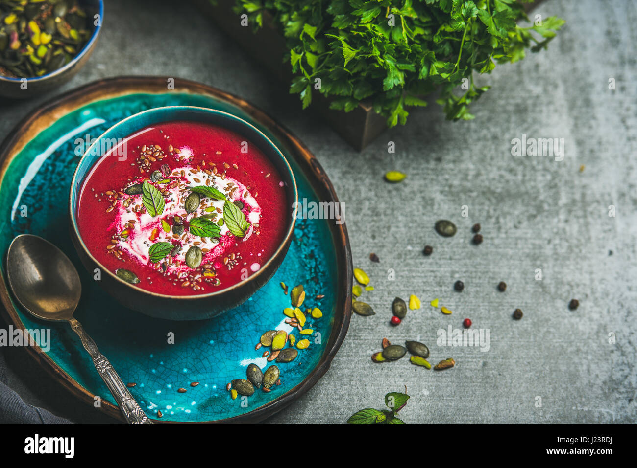 Spring beetroot soup with mint and seeds, copy space Stock Photo