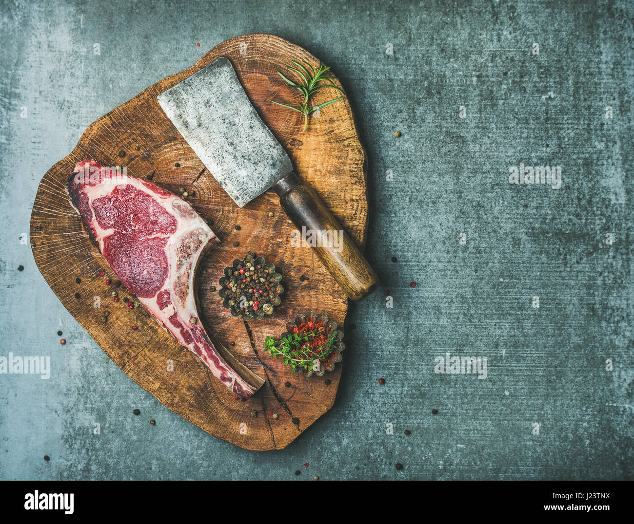 Dry aged uncooked beef rib eye steak, copy space - Stock Image
