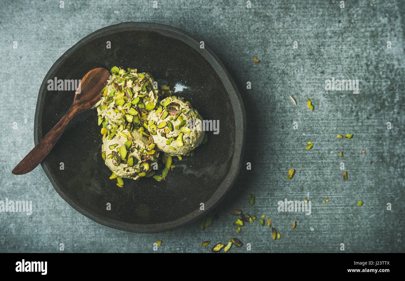 Homemade pistachio ice cream with crashed nuts, copy space - Stock Image