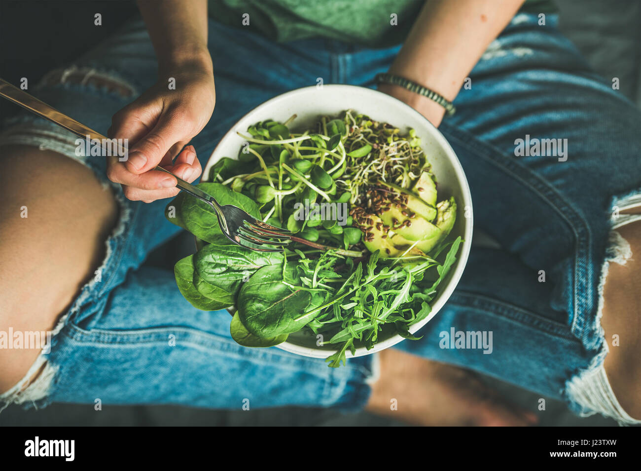Vegetarian breakfast with spinach, arugula, avocado, seeds and sprouts - Stock Image