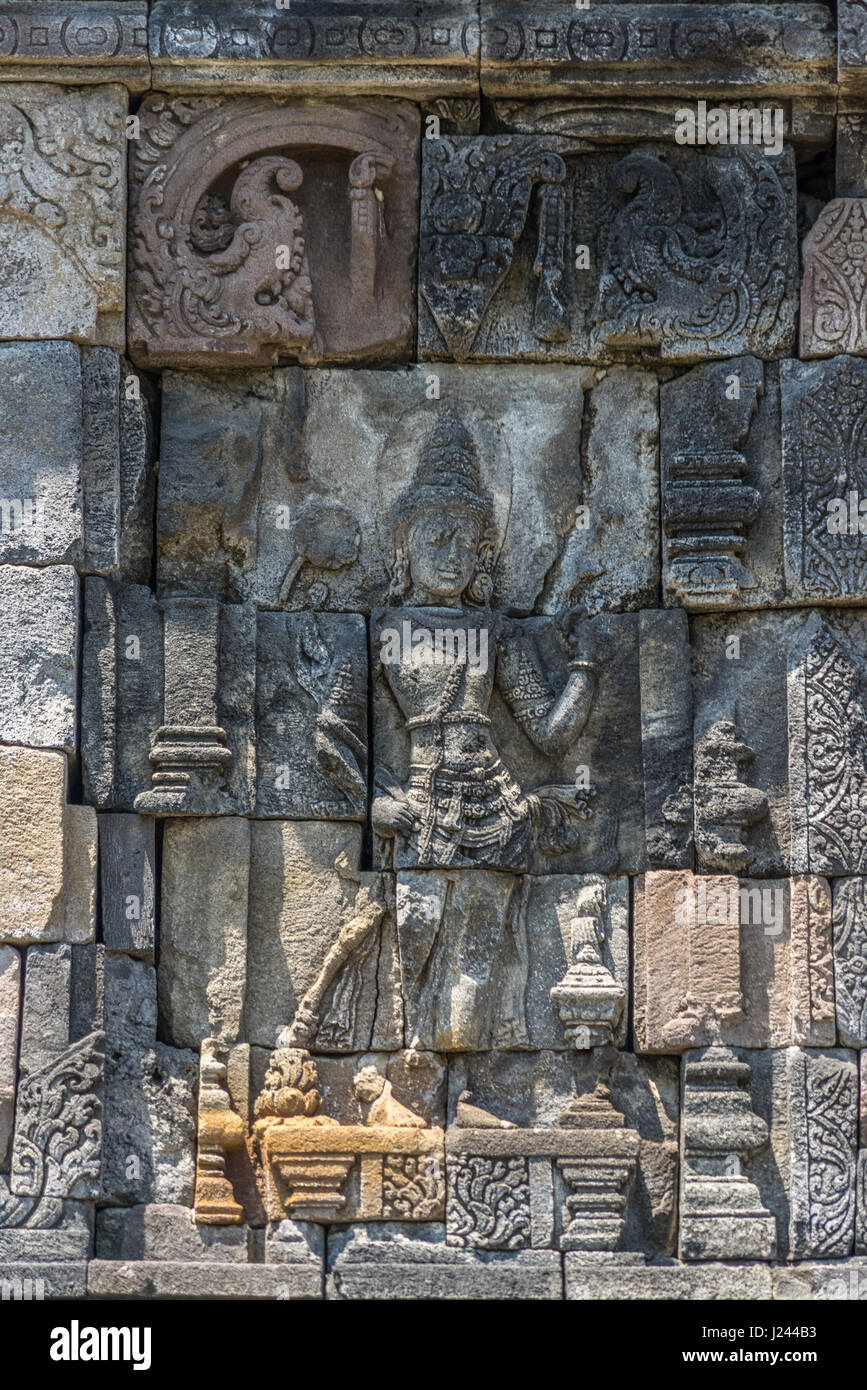 Stone craved Bas-relief of Candi Plaosan Complex, Buddhist temple divided in Plaosan Lor and Plaosan Kidul. Located - Stock Image