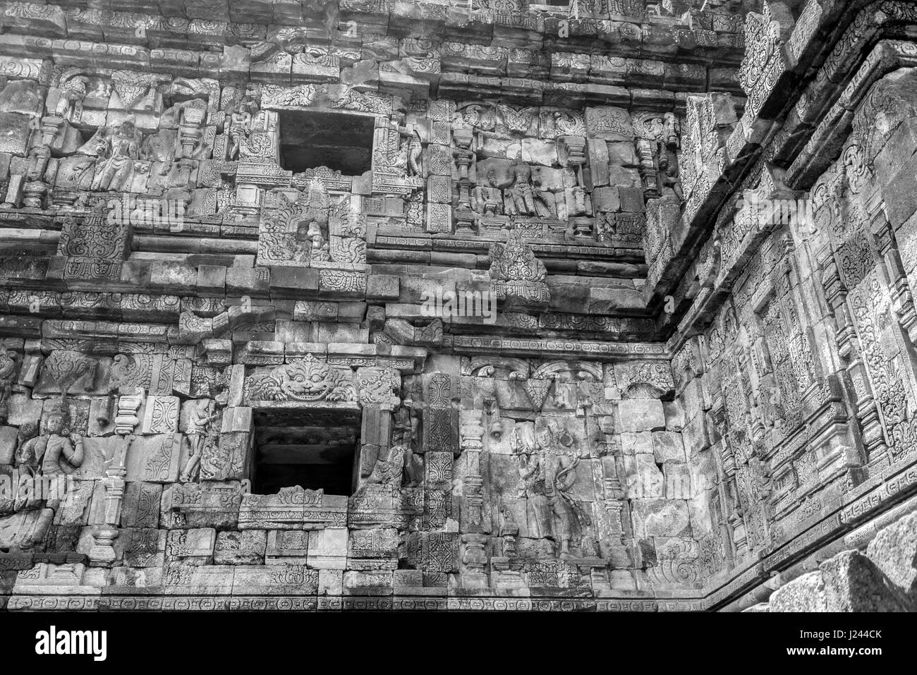 Bas-relief in Candi Plaosan Complex, buddhist temple divided in Plaosan Lor and Plaosan Kidul. Located Prambanan - Stock Image