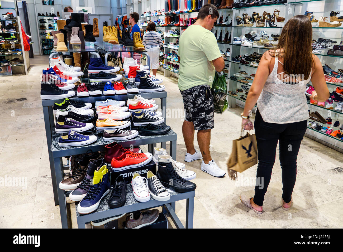 c4fccb86c526 Miami Beach Florida Lincoln Road store shopping shoes retail display  interior sneakers athletic shoes Converse lifestyle brand Hispanic man  woman cust