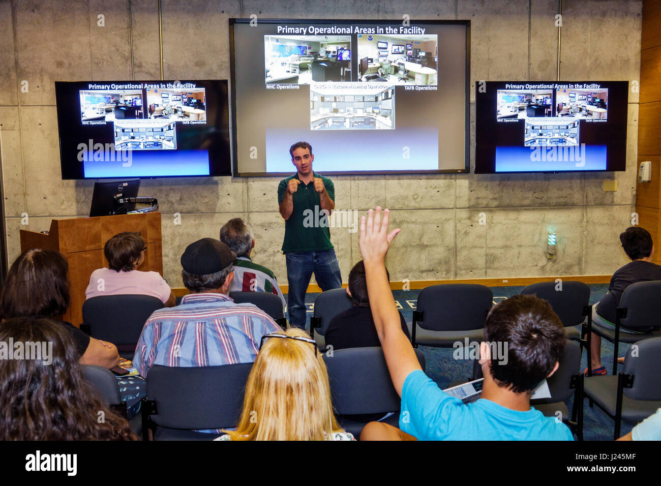 Miami Florida National Hurricane Center NHC NOAA National Weather Service open house interior presentation man audience - Stock Image