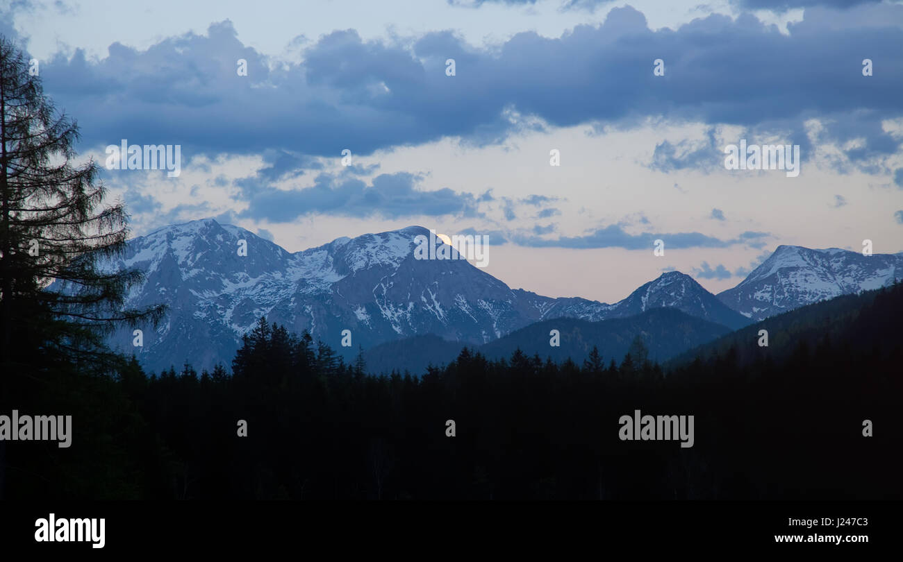 landscape in the Alps with snow-capped mountain tops and the full moon, Berchtesgadener Land, Bavaria, Germany Stock Photo