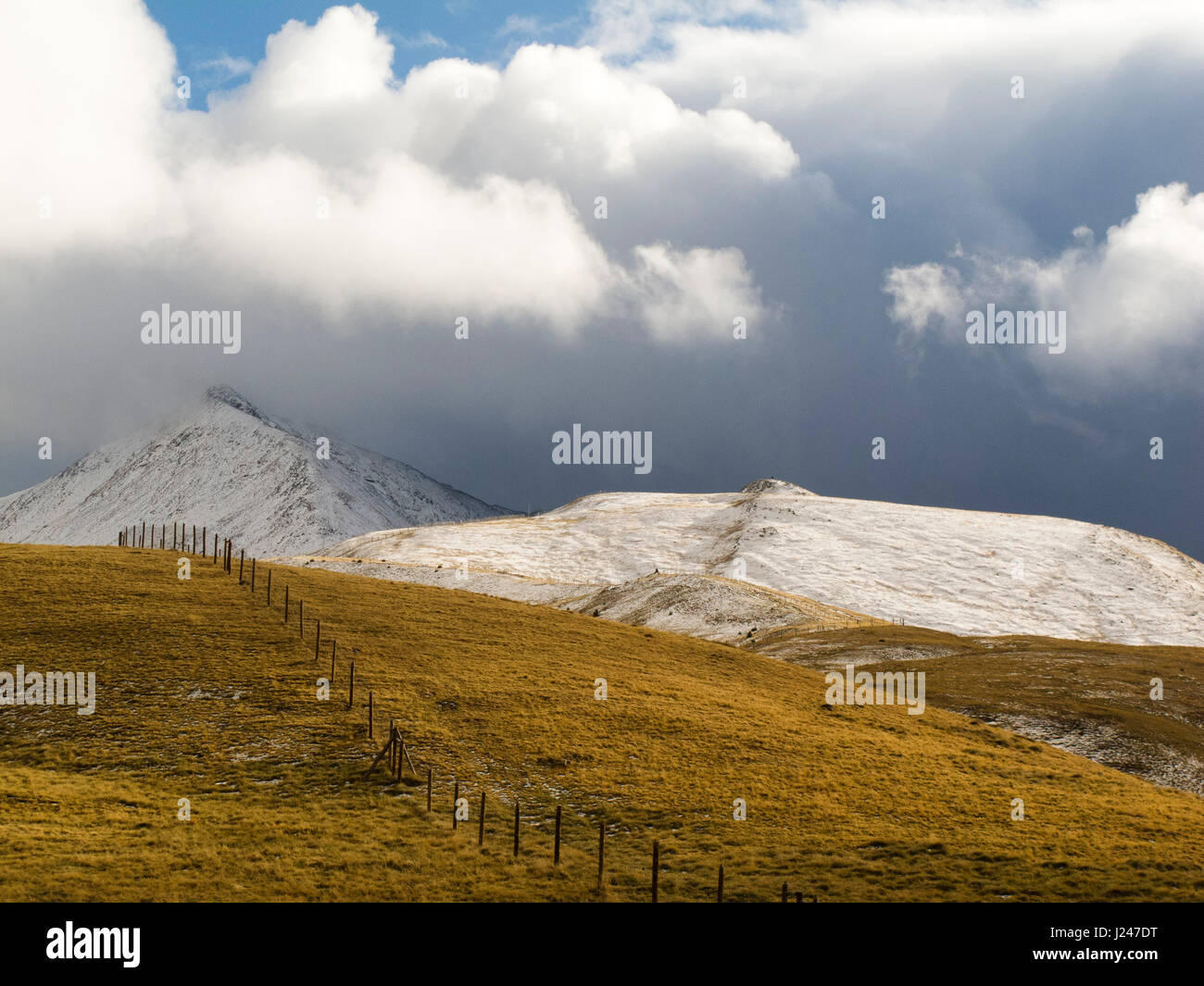 Snow covered mountain in a pyrenean landscape - Stock Image
