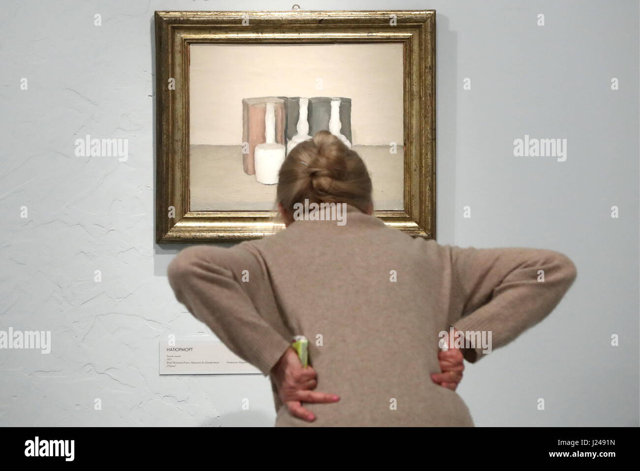 Moscow, Russia. 24th Apr, 2017. A visitor looking at a painting 'Still Life' (1953) at an exhibition of - Stock Image