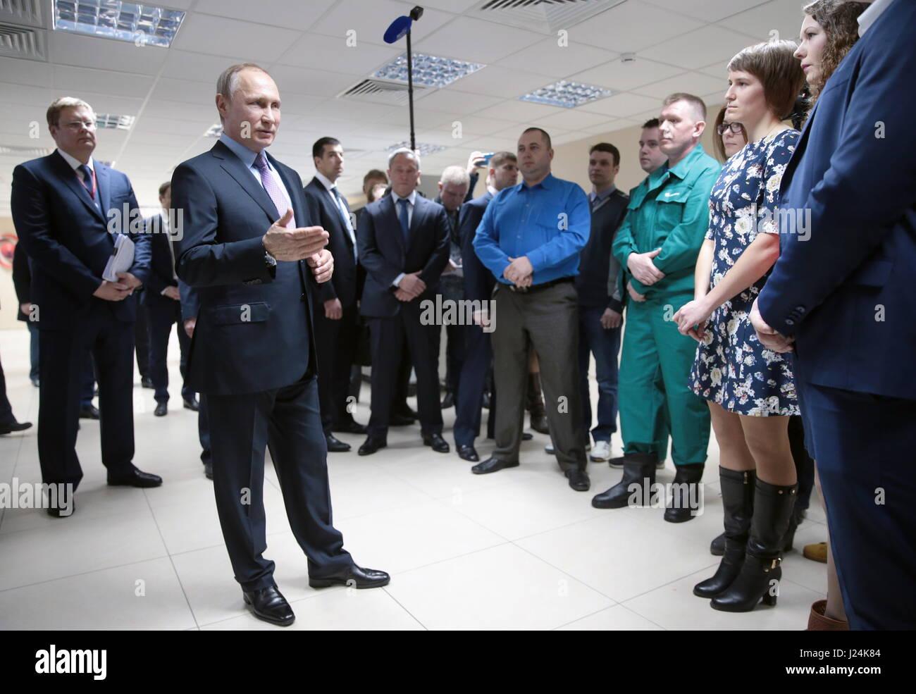 Yaroslavl Region, Russia. 25th Apr, 2017. Russia's President Vladimir Putin (L front) talks to NPO Saturn employees - Stock Image