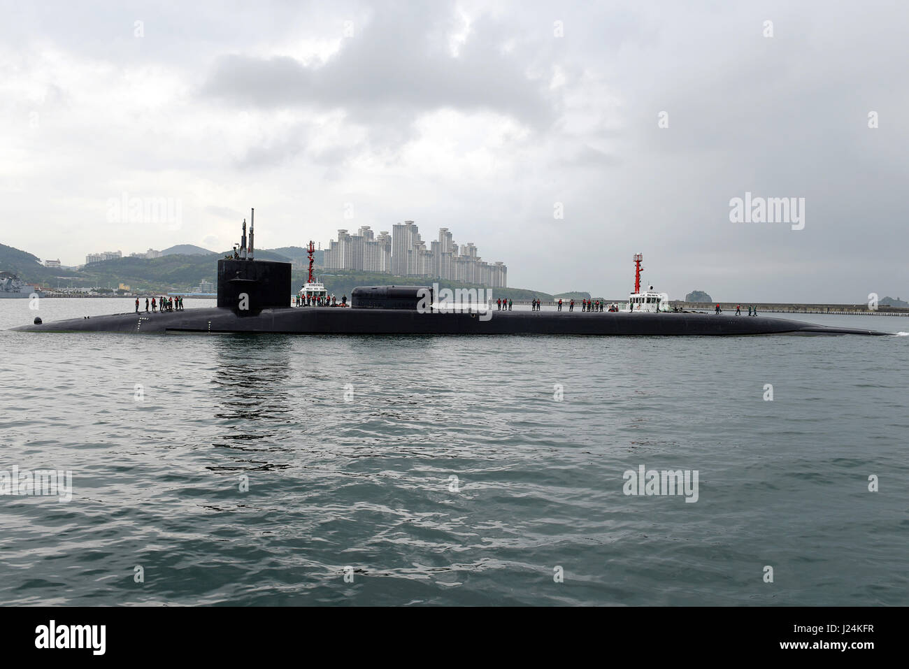 Philippine Sea. 24th Apr, 2017. The U.S. Navy Ohio-class guided-missile submarine USS Michigan comes into port for - Stock Image