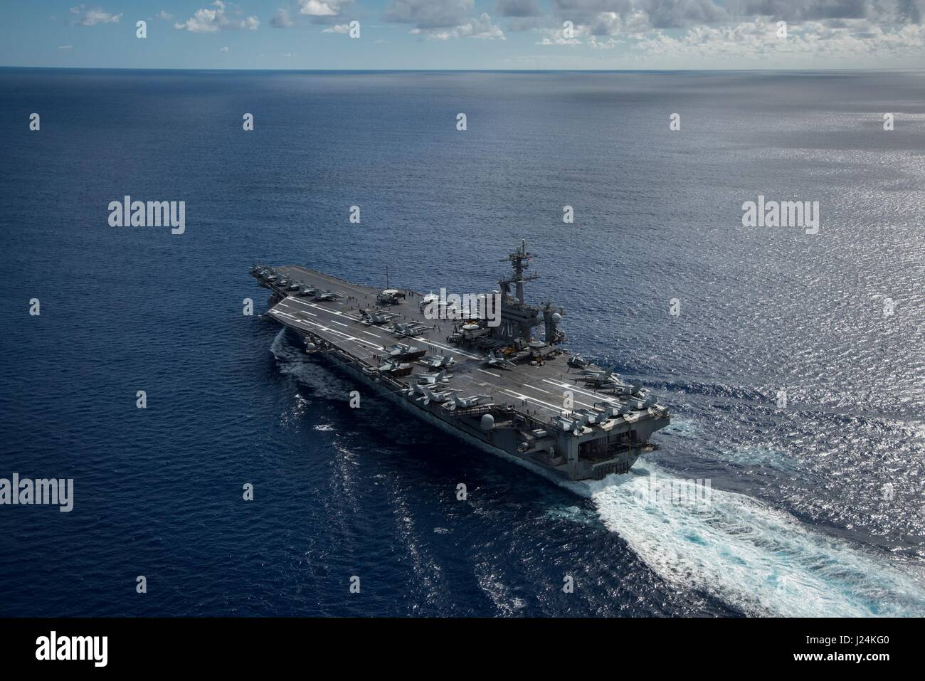 Philippine Sea. 24th Apr, 2017. The U.S. Navy Nimitz-class aircraft carrier USS Carl Vinson transits the Philippine - Stock Image