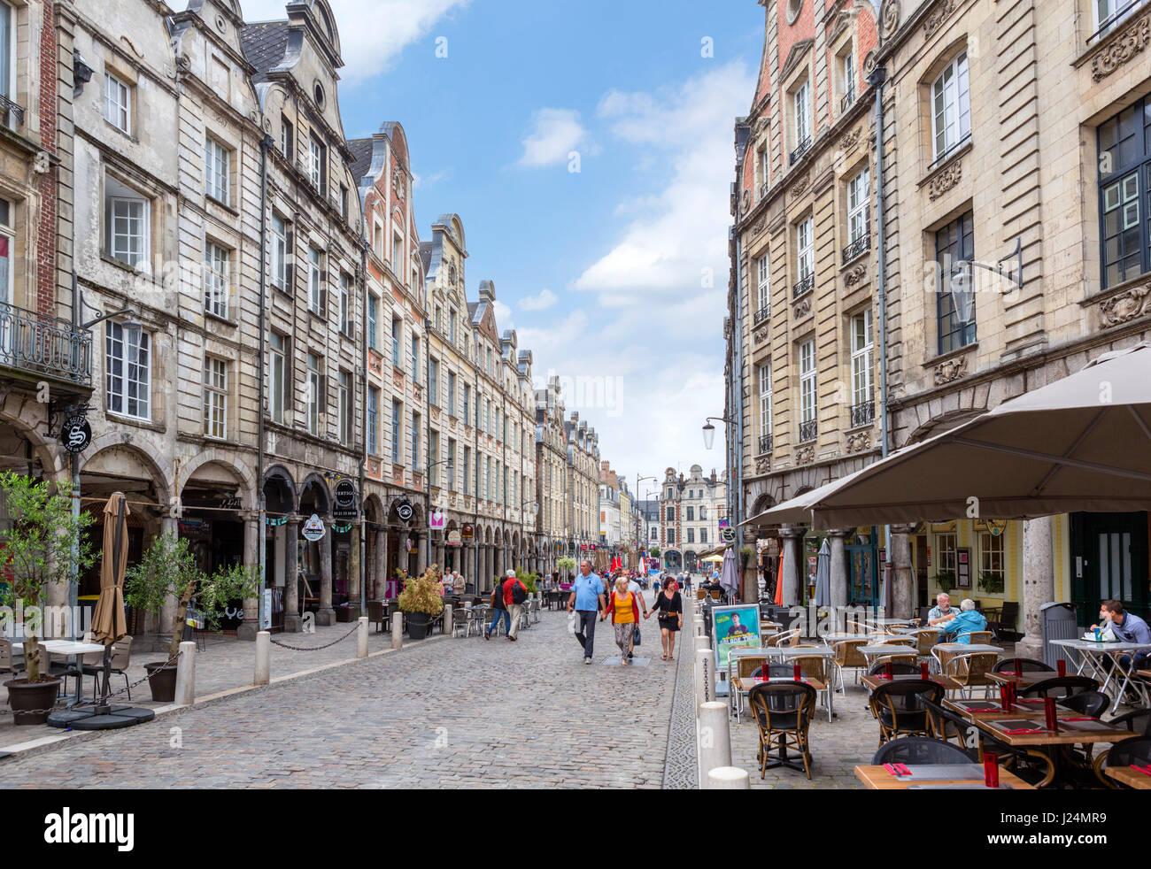 Cafe and shops on Rue de la Taillerie in the old town centre, Arras, Pas de Calais, France - Stock Image